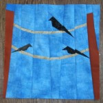 paper pieced birds on a wire quilt