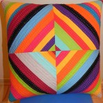 paper piecing quilted rainbow string pillow